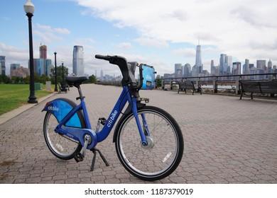 Jersey City, NJ / USA - September 24, 2018: Citi Bike on Hudson River Waterfron in Jersey City