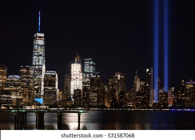 JERSEY CITY, NJ, USA - SEPTEMBER 11, 2016: The 9/11 Tribute in Lights temporary monument in lower Manhattan New York City on the 15th anniversary of the terrorist attacks. Wide view from Jersey City.