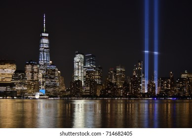 JERSEY CITY, NJ, USA - SEPTEMBER 11, 2017: The 9/11 Tribute in Lights temporary monument in lower Manhattan dominates the city skyline. This marks the 16th anniversary of the 911 terrorist attacks.