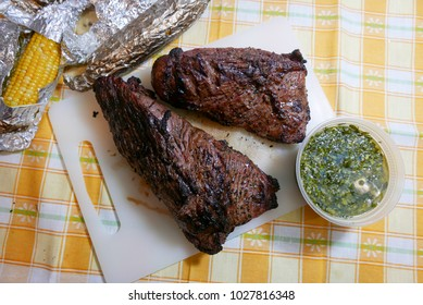 Jersey City, NJ/USA - February 2018: Grilled tri-tip steaks on the cutting board.