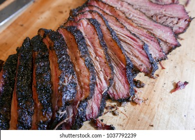 Jersey City, NJ/USA - March 2018: Sliced smoked brisket on the cutting board.