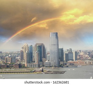 Jersey City skyline with Hudson river, aerial view with rainbow colors.