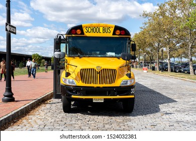 Jersey City, United States of America - Septmeber 24, 2019: A yellow school parked in Liberty State Park.
