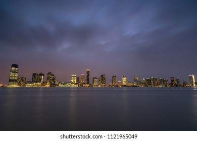 Jersey city view from Hudson river at night
