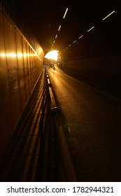 Jersey tunnel, U.K. The setting Sun shining through a transport passage.