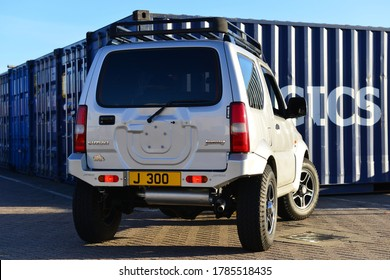 Jersey, U.K. July 28th 2020, Suzuki Jimny Vvt 4x4 1.3i vehicle parked in front of containers.