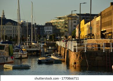 Jersey, U.K. July 6th 2020, St.Helier and harbour mixing 19th century warehouses with the new town at high tide near sunset.