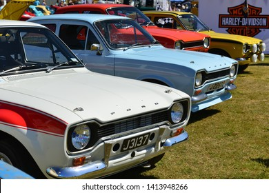 Jersey, U.K. June 1st 2019. A group of 70's Mexico Mk1 Ford Escorts at Jersey's International motoring festival at People's Park St Helier.