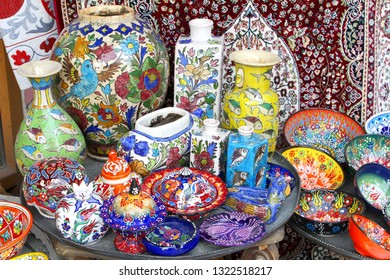 JERSUSALEM, ISRAEL - February 14, 2019. Colorful ceramic pottery set in a arts and crafts shop in Mahane Yehuda souk market in old city.