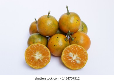 Jeruk kasturi ( in Indonesian ) or calamansi on white background