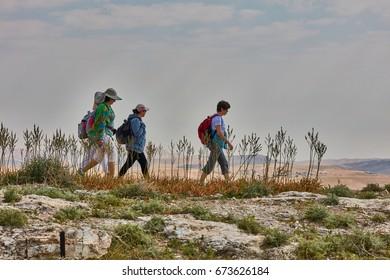 Jerusalem - 10.04.2017: Group of people trekking in the mountais near Jerusalem