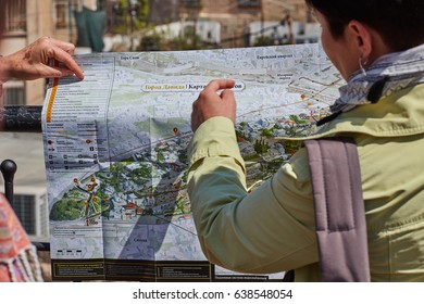 Jerusalem - 15 November, 2016: Tourists looking at the map of Jerusalem