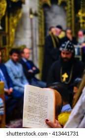JERUSALEM - APR 28, 2016: Washing of the Feet ceremony, in the Syrian Orthodox St. Marks church, with the patriarch and community members. Orthodox Holy Thursday in the old city of Jerusalem, Israel