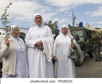 JERUSALEM - APRIL 01 : Unidentified nuns take part in the Palm sunday procession in Jerusalem on April 01 2012