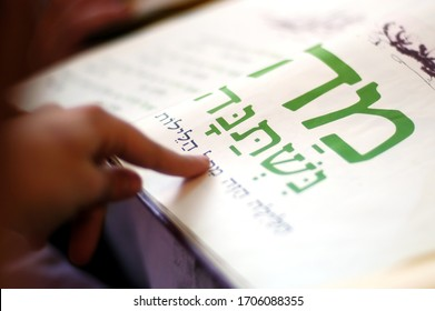 JERUSALEM - APRIL 02 2007:Jewish person reads the Haggadah. The Haggadah is a Jewish text that sets forth the order of the Passover Seder on Passover Jewish Holiday.