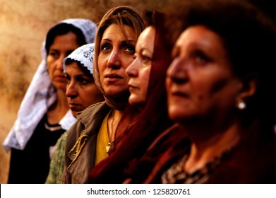 JERUSALEM - APRIL 08:Cristian women pray during Easter mass at the Holy Sepulchre on April 08 2007 in Jerusalem, Israel.The Church considered to be the holiest Christian site in the world.