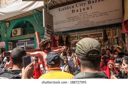 JERUSALEM - APRIL 18, 2014: A group of American actors re-enchant the crucifixion of Jesus Christ along the stations of Via Dolorosa, on Good Friday, in the old city of Jerusalem, Israel