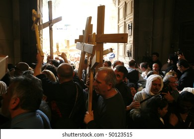 JERUSALEM - APRIL 2: a crowd of pilgrims enters the temple of the Holy Sepulcher with crosses on Good Friday April 2, 2010 in Jerusalem, Israel.