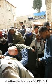 JERUSALEM - APRIL 2: Pilgrims come to Holy Sepulchre for pray, on Good Friday April 2, 2010 in Jerusalem, Israel.