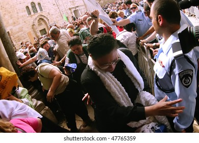 JERUSALEM - APRIL 21: Pilgrims come to Holy Sepulchre for pray, before a ceremony of Crucession, entering to the Temple, on Good Friday April 21, 2006 in Jerusalem, Israel.