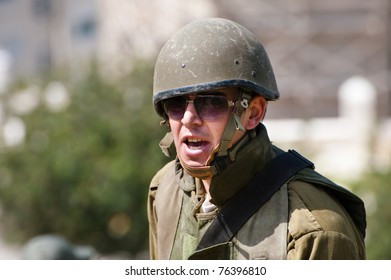 JERUSALEM - APRIL 22: The face of an unidentified Israeli soldier on duty in the Palestinian neighborhood of Al-Isawiyya in East Jerusalem on April 22, 2011.