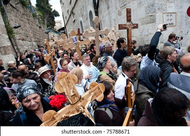 JERUSALEM - APRIL 22: Orthodox Christian pilgrims commemorate the path Jesus carried his cross on the day of his crucifixion along the Via Dolorosa in Jerusalem on Good Friday, April 22, 2011.