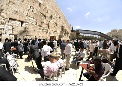 JERUSALEM - APRIL 25: Jewish prayers and  pilgrims beside Western Wall April 25, 2011 in Jerusalem, Israel.