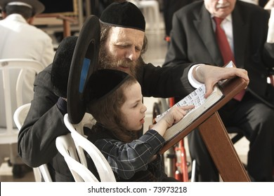 JERUSALEM - APRIL 4: Unidentified dad teaching his unidentified son from the Hebrew holy books on April 4, 2008 in Jerusalem. The best way to teach children is from parent to child!