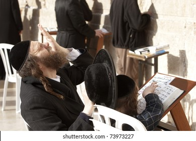 JERUSALEM - APRIL 4: Unidentified father praying for his unidentified son and teaching him from the Hebrew holy books on April 4, 2008 in Jerusalem.