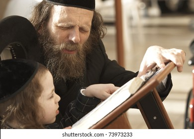 JERUSALEM - APRIL 4: Unidentified father teaching his unidentified son from the Hebrew holy books on April 4, 2008 in Jerusalem.  The best way to teach children is from parent to child!