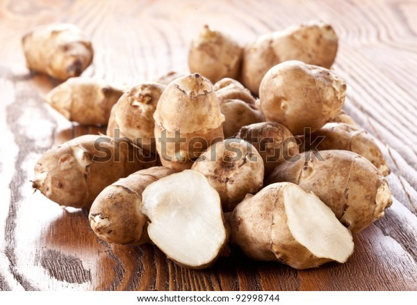 Jerusalem artichoke on a wooden table