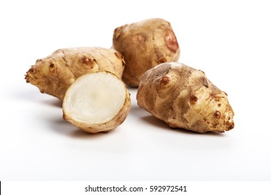 Jerusalem artichoke with white background, close up