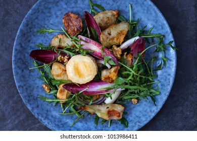 Jerusalem artichokes and grilled goat cheese salad with chicory and rocket