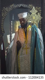 JERUSALEM - AUGUST 08 : Ethiopian priest prays at the Ethiopian Church in Jerusalem , Israel on August 08 2012 , Ethiopian church is The only pre-colonial Christian church of Sub-Saharan Africa