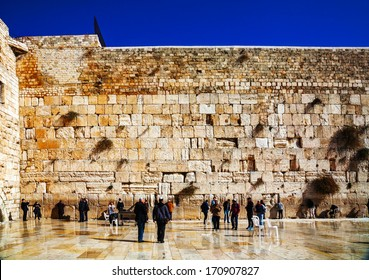 JERUSALEM - DECEMBER 15: The Western Wall in the night on December 15, 2013 in Jerusalem. It's located in the Old City of Jerusalem at the foot of the western side of the Temple Mount.
