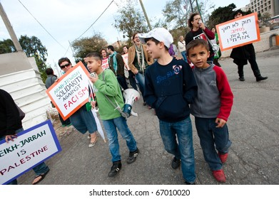 JERUSALEM - DECEMBER 3: unidentified Activists stage a demonstration in the Sheikh Jarrah neighborhood of East Jerusalem on Dec. 3, 2010 to protest the takeover of Palestinian houses by Jewish settlers.