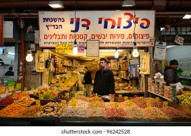 JERUSALEM - FEBRUARY 16: An Israeli vendor sells dried fruits and nuts in a souq February 16, 2012 in Jerusalem, IL. Souqs are markets common to the middle east which sell food and other essentials.