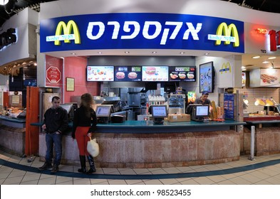 """JERUSALEM - FEBRUARY 19: Mcdonald's February 19, 2012 in Jerusalem, IL.The trademark yellow and red signs are replaced at some Israeli branches with blue and white signs with the Hebrew word """"kosher."""""""