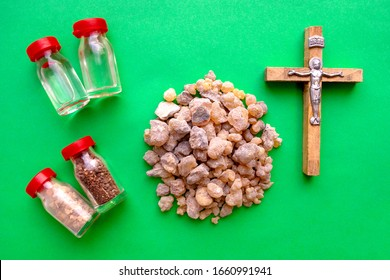 Jerusalem Frankincense, Holy water, Holy oil, Holy Earth and Olive Wood Crucifix on green background. Christian Gifts.