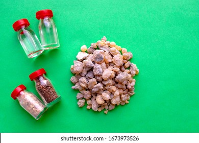 Jerusalem Frankincense, Holy water, Holy oil and Holy Earth on green background with copy space. Christian Gifts.