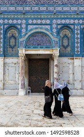 "Jerusalem, Isarael - June 11. 2016: Three undentified  Arabian women at Dome of the Rock (The inscription on gate: ""In the name of God the Merciful, the Compassionate. There is no god but God alone."""