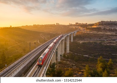 Jerusalem, Israel - 09-24 2019: A train connecting Jerusalem to ben Gurion airport crossing a bridge on the outskirts of Jerusalem at sunrise
