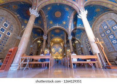 Jerusalem, Israel - 12.12.2018: Tourists and pilgrims visiting the Church of All Nations in Jerusalem Old City. The Jerusalem Old City is home to several sites of key religious importance.