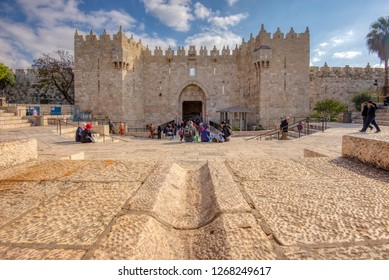 Jerusalem, Israel - 12-18-2018: Tourists and locals at the Damascus Gate entrance to the old city.