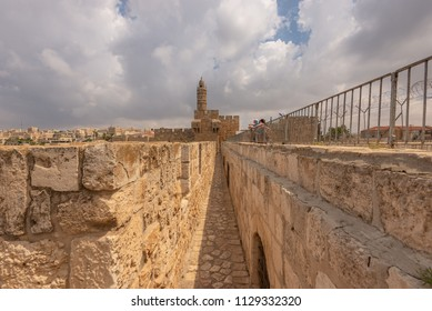 Jerusalem, Israel: 13 June, 2018: Tourists looking out to the Jerusalem skyline from the Old City walls.