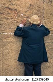 Jerusalem, Israel: 13 June, 2018: A man praying at the Wailing Wall in Jerusalem