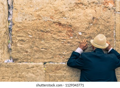Jerusalem, Israel: 13 June, 2018: A man praying at the Wailing Wall in Jerusalem