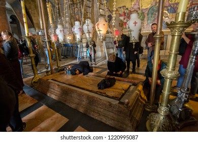 Jerusalem, Israel - 15 February 2018: Holy grave stone in the church of the Holy Sepulchre in Jerusalem