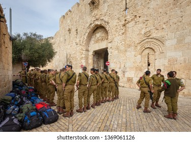 Jerusalem, Israel - 16 December, 2018: A group of young IDF soldiers preparing to take a tour of the Old City of Jerusalem at Zion Gate