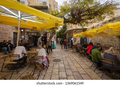 Jerusalem, Israel - 16 December, 2018: Tourists eating at an outdoor cafe in the Jewish Quarter of the Old City